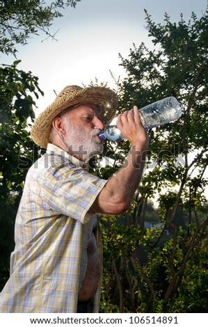 a farmer man drinks water