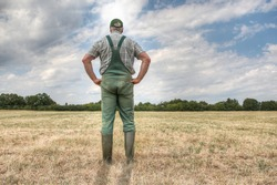 A farmer stands on his parched meadow and hopes for rain while the sun shines mercilessly on his farmland. Rising temperatures and too little rain the arable land in Germany is dry like never before.