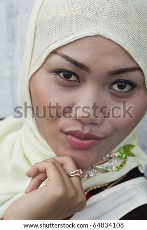 A Fashion Portrait of a Beautiful young Indonesian Muslim Woman in Sumatra!