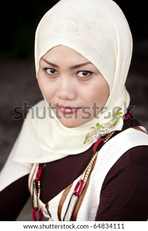 A Fashion Portrait Of A Young Beautiful Indonesian Muslim Woman with Headscarf!