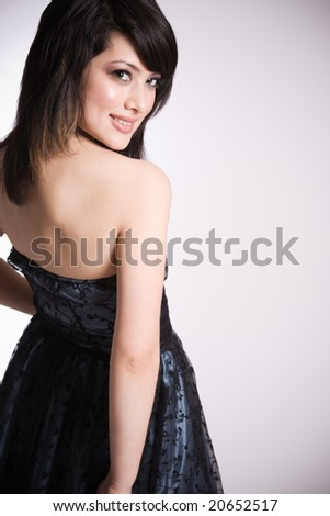 A fashion shot of beautiful smiling asian girl