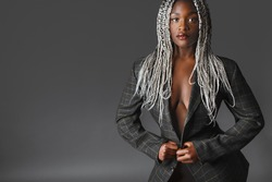 a fashionable african woman with dreads in a jacket