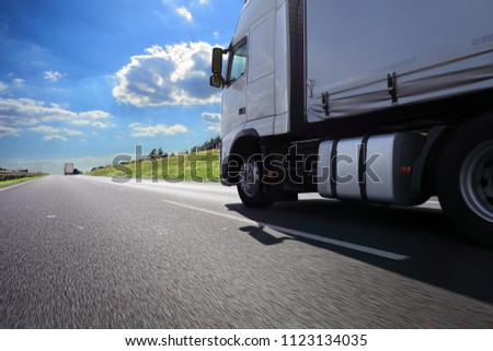 A fast truck running on the highway #1123134035