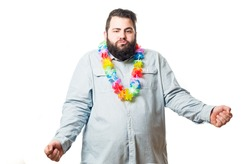A fat man with shirt and a necklace of flowers on his neck isolated on white background