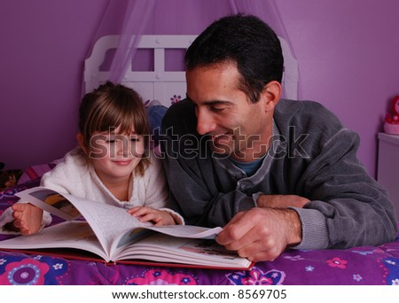 A father and daughter spend time reading a book