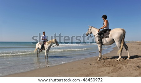 a father and his daughter with their horses in holidays