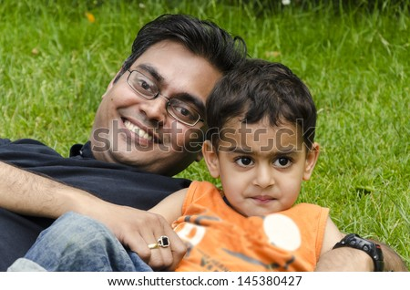 stock-photo-a-father-and-son-playing-together-in-a-garden-145380427.jpg