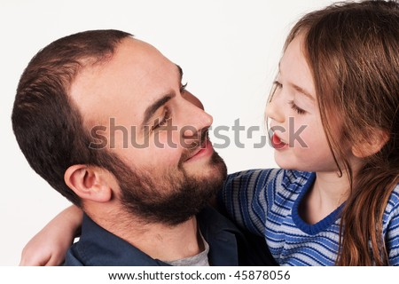 a father and young daughter having a conversation