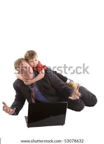 A father trying to work on his laptop while his son his hanging on his shoulders with a sad expression on his face.