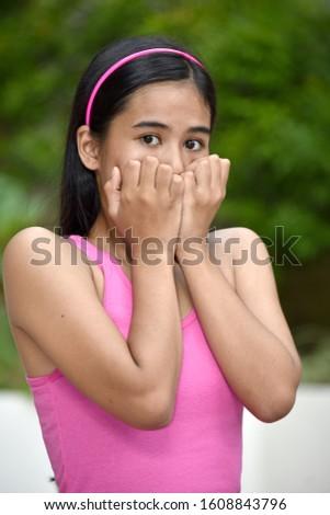 A Fearful Youthful Filipina Teenager Girl