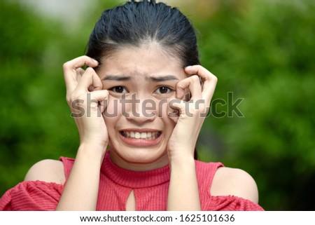 A Fearful Youthful Minority Female