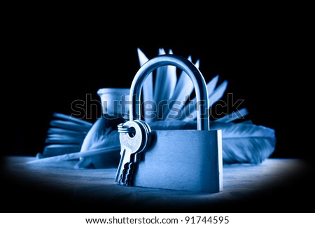 A feather, inkpot, old book and keylock in blue