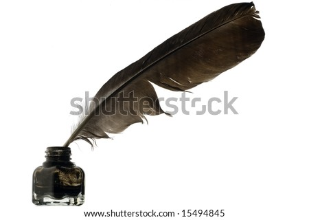 a feather quill in an ink bottle on white