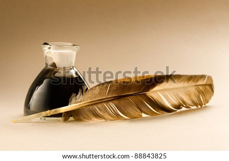 A feather with the bottle full of ink