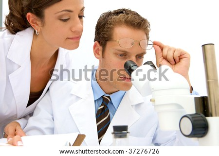 A female and male scientist working in a lab
