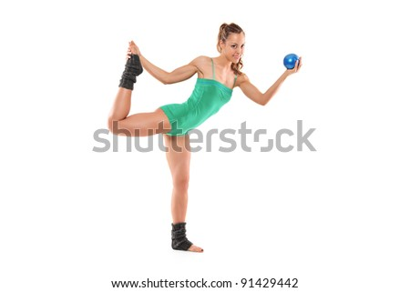 A female athlete working out with a ball isolated on white background