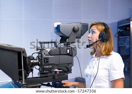 a female cameraman at a studio during live broadcasting