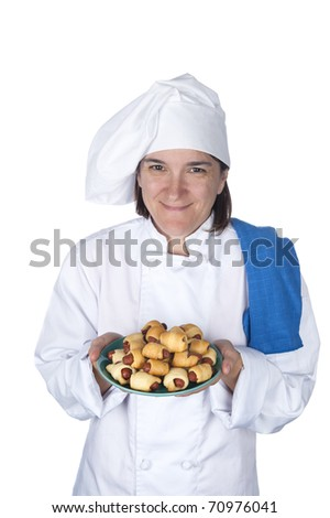 A female chef shows off her latest meal.  Isolated on white for designer convenience.