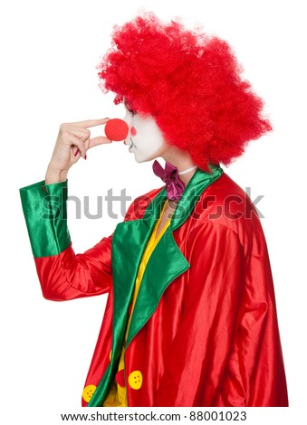 a female clown with colorful clothes and makeup squeezing her nose