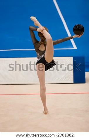 A female competitor in a Rhythmic Gymnastics event