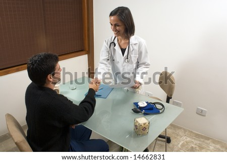 A female doctor is smiling and shaking hands with her patient.  The doctor and the patient are looking at each other.  Horizontally framed photo.