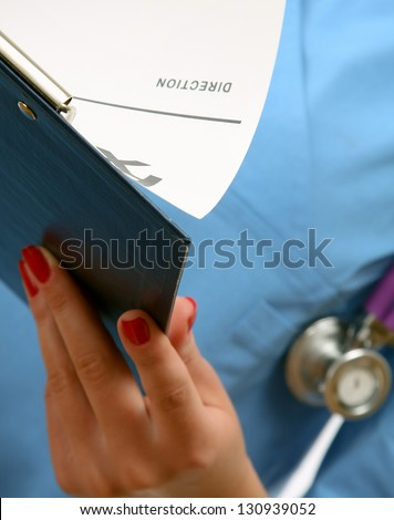 A female doctor with a folder , isolated on white background