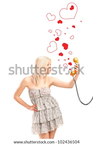 A female giving kisses and holding a telephone tube with red hearts around isolated on white background