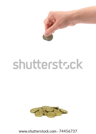 A female hand dropping coin isolated against a white background