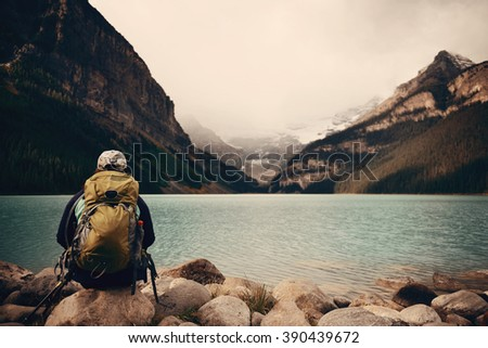 a female hiker at lake louise...