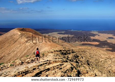 A female hiker on a mountain trail on Lanzarote, in the Spanish Canary Islands.