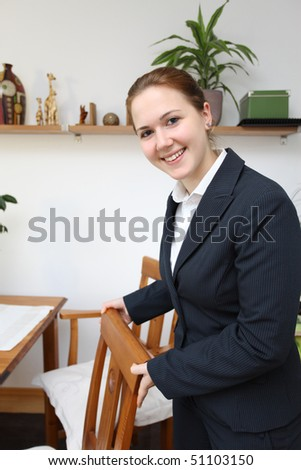 A female hotel manager offering a seat