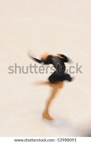 A female ice-skater in action.