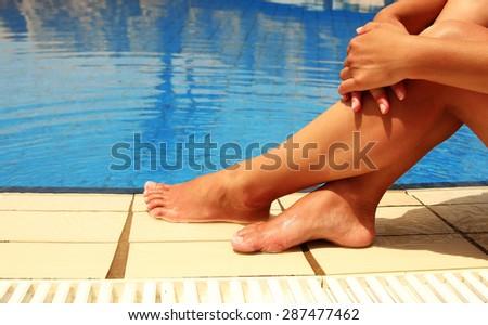 a female legs in the pool water pool
