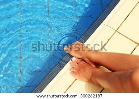 a female legs in the pool water pool,