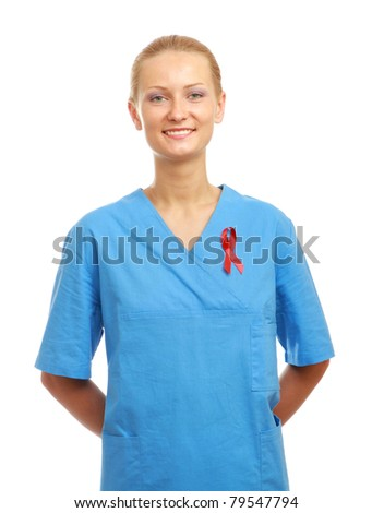 A female nurse with an aids red ribbon pinned to her uniform, isolated on white