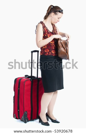 A female passenger searching for something in her bag