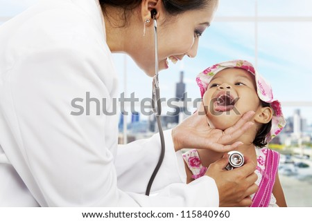 A female pediatrician is checking cute girl patient's throat