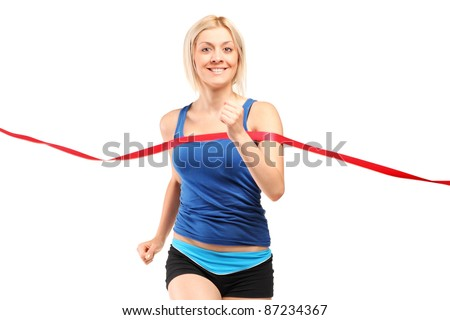 A female runner running towards a finish line isolated on white
