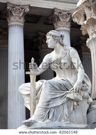 A female statue representing the executive powers of the state, part of the The Athena Fountain (Pallas-Athene-Brunnen) situated in front of the building of Austrian Parliament.