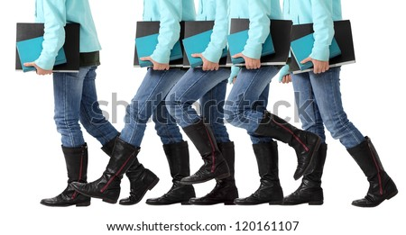 A female student advances toward her goal of graduation for a degree and diploma isolated on white
