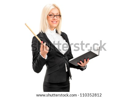 A female teacher posing with a book in her hand isolated on white background