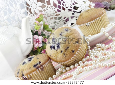A feminine tea party  with fresh baked blueberry muffins