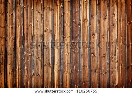 A fence made of old larch boards - grunge background