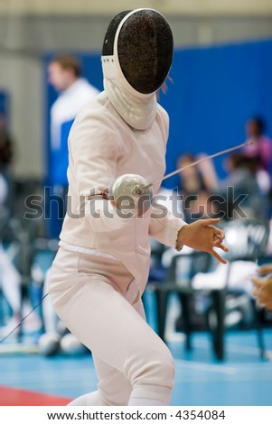 a fencer in a stance - stock photo