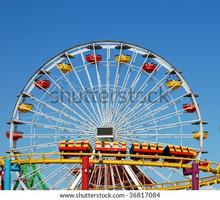 a ferris wheel and rollercoaster at an amusement park