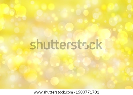 A festive abstract delicate golden yellow gradient background texture with glitter defocused sparkle bokeh circles. Card concept for Happy New Year, party invitation, valentine or other holidays. #1500771701