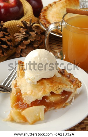 A festive display of fresh apple pie with ice cream and hot cider