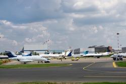 A few business jets at the plane parking. Follow-me-car