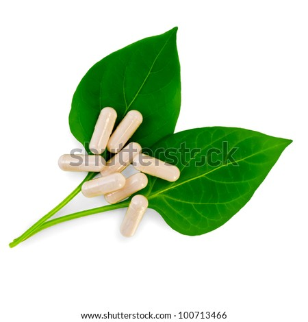 A few capsules on the two green leaves isolated on white background