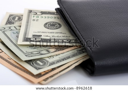 A few dollar bills inside a leather wallet - stock photo